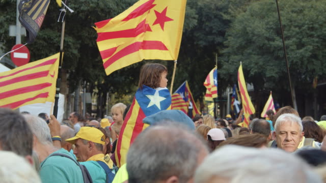 child with a flag at catalonia demonstration movement for the independence from spain. barcelona during 11 september 2018, catalan national day - referendum stock videos & royalty-free footage