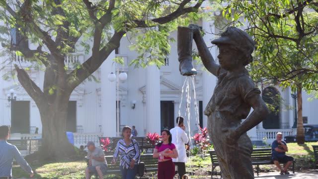 child with boot fountain, santa clara, cuba - luogo d'interesse locale video stock e b–roll