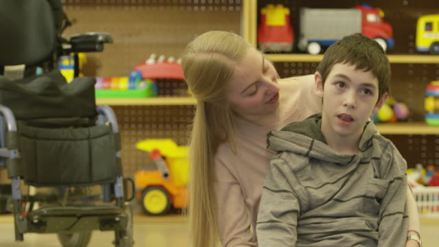 Child with Disability Laughing with Caregiver
