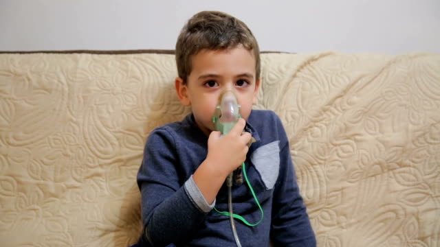 child with inhaler - oxygen mask stock videos and b-roll footage