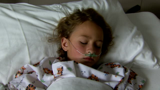 child with respirator in hospital bed sleeping - children's hospital stock videos & royalty-free footage