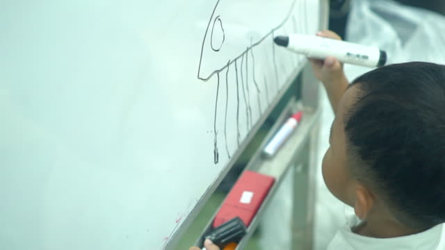 child writing mathematics on a board - subtraction stock videos & royalty-free footage
