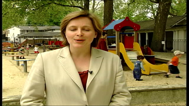 Government plans tax relief for nannies ITN EXT i/c Vox pops Young children playing on rocking horse in park playground