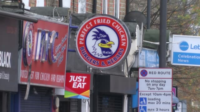 London Mayor calls for ban on fast food takeaways near to schools Stoke Newington Reporter chatting with kebab shop owner Price board in kebab shop...