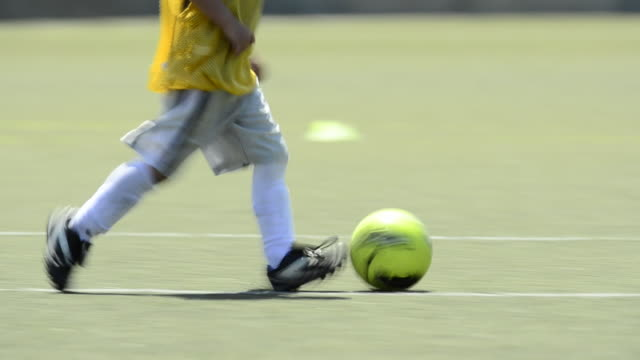 children ages 5-7 playing soccer/ football. - 1920x1080 - kicking stock videos & royalty-free footage