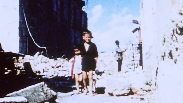 children amid wreckage of war including casualties in situ / italy - 死傷者点の映像素材/bロール