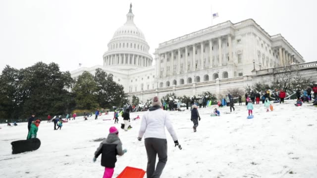 children and adults snow sled on the grounds of the us capitol march 21 2018 in washington dc an early spring storm brought several inches of snow to... - eastern usa stock videos and b-roll footage