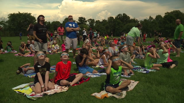 ktvi children and adults watch 2017 solar eclipse on aug 21 2017 in grover missouri - solar eclipse glasses stock videos and b-roll footage