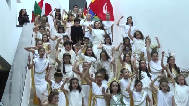 Children and dancers perform a show and musicians perform during the reopening ceremony at Bardo Museum after a oneweek closure following a militant...
