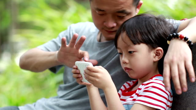 Children and fathers Using Smart Phone
