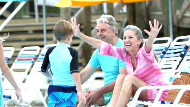 children and grandparents hugging poolside - poolside stock videos & royalty-free footage
