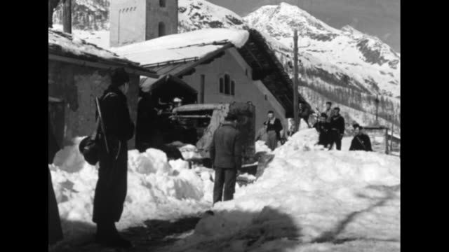 vidéos et rushes de children and others with church bells on the snowy ground with men trying to pull one / vs a bulldozer pushes a large mound of snow; view of tall... - prêtre