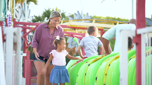 children and parents getting on amusement park ride - 8 9 years stock videos & royalty-free footage