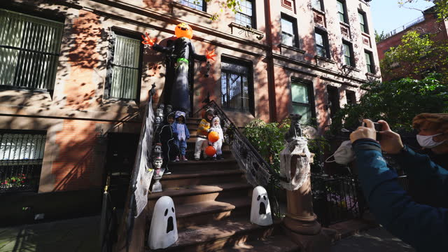 children and parents visit to the one of popular halloween decorations in upper east manhattan area. people take photographs and enjoy to watch the... - baby boys stock videos & royalty-free footage