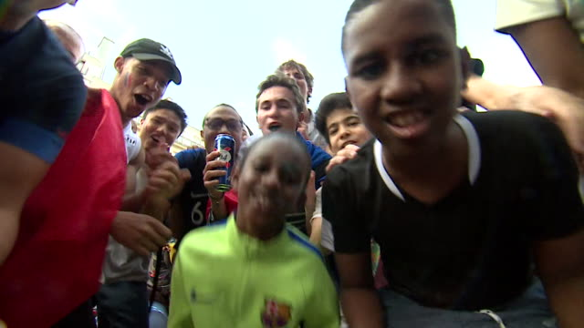 children and young people look into camera whilst singing 'champions du monde' 'champions of the world' on the day of france's world cup win 15th... - singing stock videos & royalty-free footage