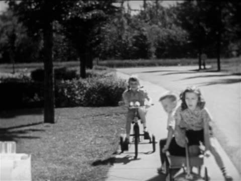 b/w 1950 3 children approaching lemonade stand on wagon + tricycle / boy at stand pouring lemonade - lemonade stock videos and b-roll footage