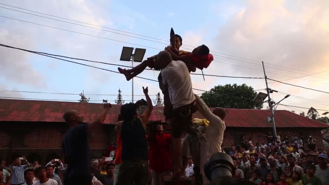 """children are seen carried on a chariot by balancing them on the tips of wooden prongs during a procession in """"trishul jatra"""" or tridents festival in... - balance stock videos & royalty-free footage"""