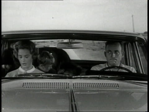1963 MONTAGE Children arguing in car speeding down highway / United States