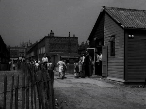 children arrive at a youth club hut. 1957 - youth club stock videos & royalty-free footage