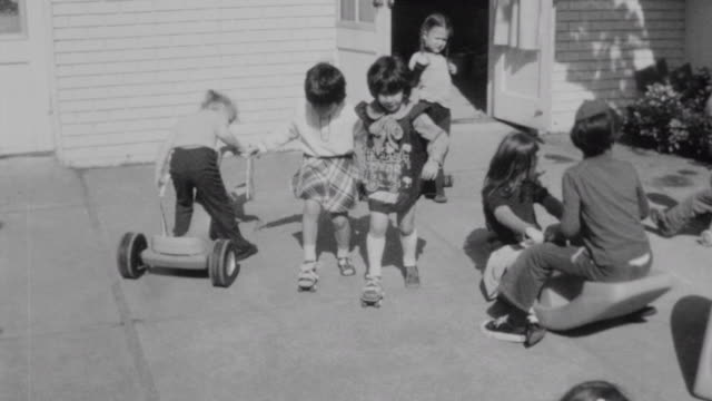 stockvideo's en b-roll-footage met children arrive at pacific northwest chabad nursery school / children playing in playground / chabad nursery arrival on october 01 1975 in seattle... - orthodox jodendom