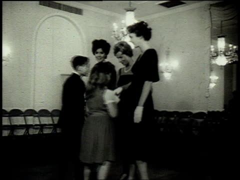 1962 montage children arriving for dance class / united states - regole dell'etichetta video stock e b–roll