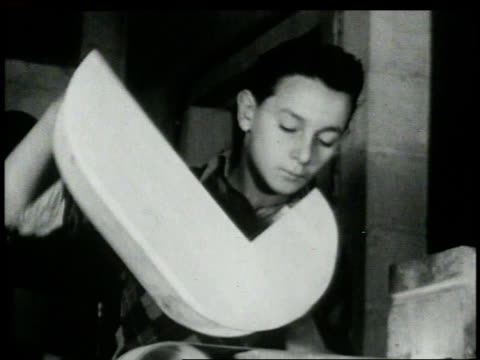 1946 montage children at a boys club working with woodworking equipment and building model airplanes / new york, new york, united states  - sanding stock videos & royalty-free footage