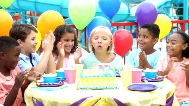 children at birthday party, blowing out candles on cake - 8 9 years stock videos & royalty-free footage