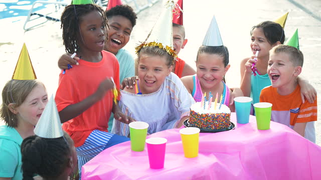 children at birthday party, ready for cake - party hat stock videos & royalty-free footage
