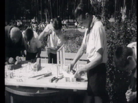children at camp propaganda for children children making model airplanes feeding rabbits playing chess reading books embroidering while children... - embroidery stock videos & royalty-free footage