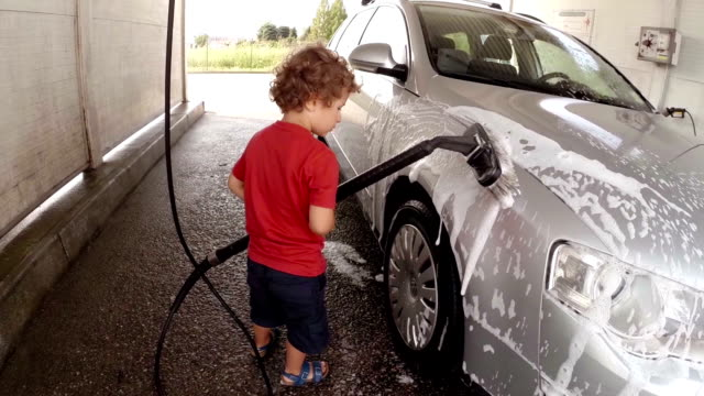 stockvideo's en b-roll-footage met children at car wash - pjphoto69