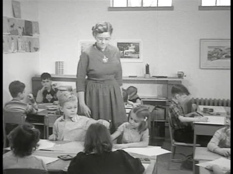 levittown pennsylvania dramatization children at connected desks coloring 'principle joseph roberts' bring mother daughter in to classroom to meet... - levittown pennsylvania stock videos and b-roll footage