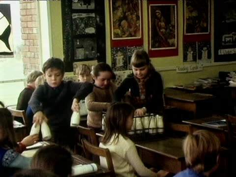 children at junior school collect and drink milk placing empty bottles back in crate merthyr tydfil; 1971 - primary school child stock videos & royalty-free footage