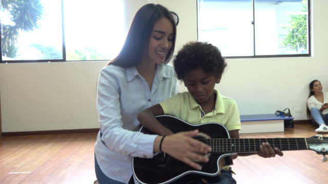 children at music class having fun playing instruments - plucking an instrument stock videos and b-roll footage