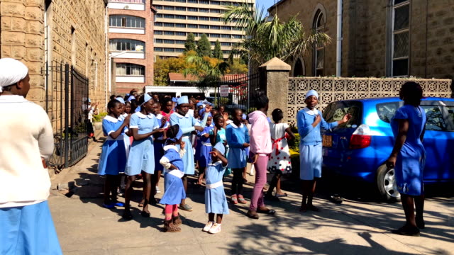 children attend sunday school at the cathedral of the sacred heart of jesus on august 05 2018 in harare zimbabwe zimbabwe electoral commission... - sonntag stock-videos und b-roll-filmmaterial