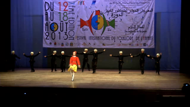 children band performing traditional dance on stage during the international folklore festival in the city of rabat morocco rabat international... - 8歳から9歳点の映像素材/bロール