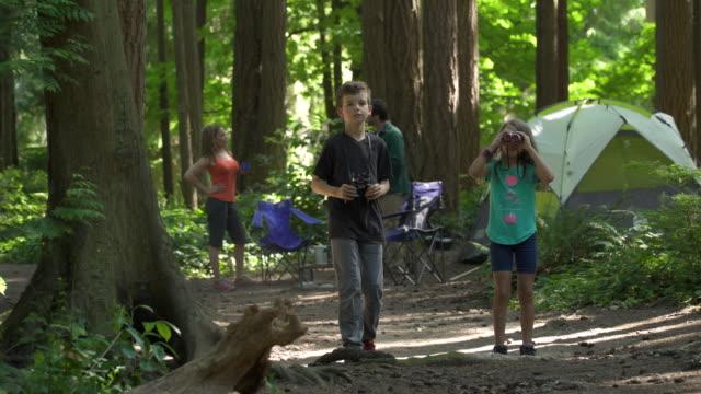 children bird watching on camping trip