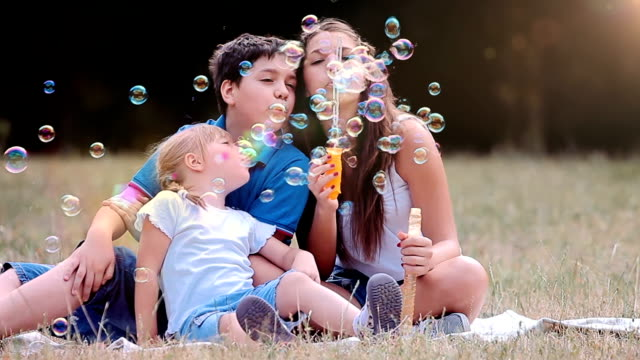 children blowing bubbles - domestic garden stock videos & royalty-free footage