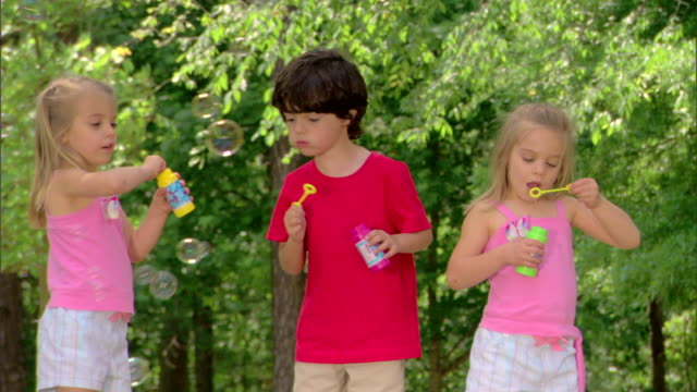 children blowing bubbles - see other clips from this shoot 1428 stock videos & royalty-free footage