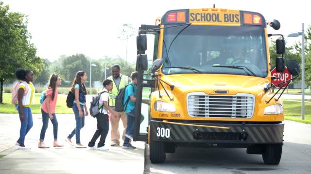 children boarding school bus - 12 13 years stock videos & royalty-free footage