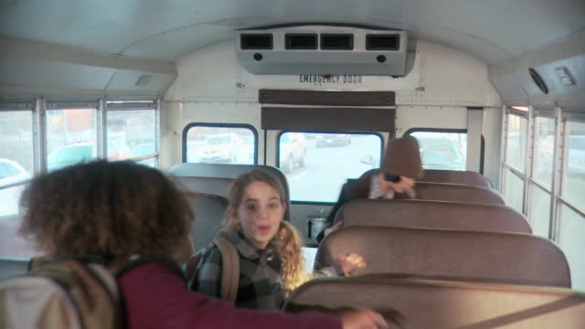 children boarding school bus - primary school child stock videos and b-roll footage