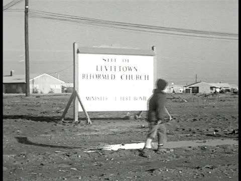 children boys walking on muddy vacant lot in front of site sign for 'reformed church' ws sign on empty lot 'reform jewish temple' ms sign for future... - levittown pennsylvania stock videos and b-roll footage