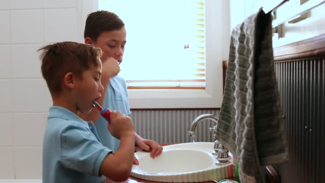 children brushing teeth before school - bathroom sink stock videos & royalty-free footage