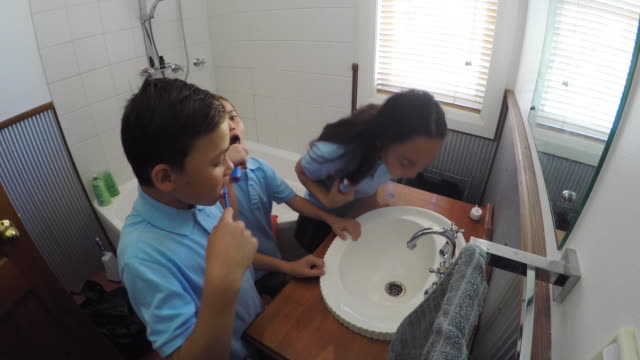 children brushing their teeth - preparation stock videos & royalty-free footage