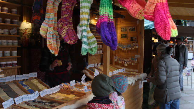 children buying some gifts on the market christmas market with christmas decoration in germany visitors are enjoying arts and crafts and are tasting... - advent calendar stock videos & royalty-free footage