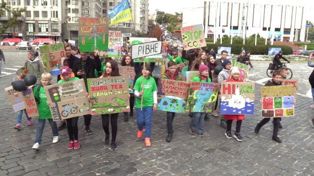 children carry posters and shout slogans during the 'global climate strike' climate change action protest in kiev, ukraine, on 20 september, 2019.... - strike protest action stock videos & royalty-free footage