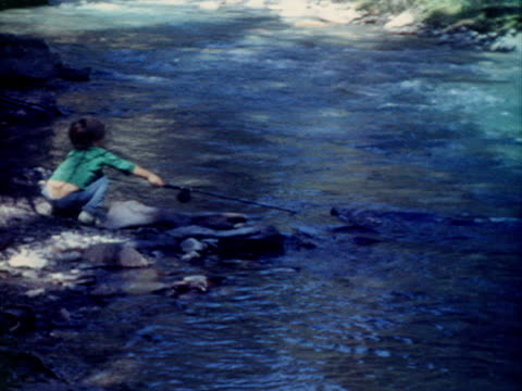 children cast fishing poles in a river. - fishing stock videos and b-roll footage