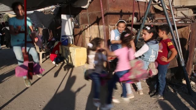 children celebrate at a playground installed for the occasion of eid aladha in the northwestern syrian city of idlib on august 1 2020 eid aladha... - obedience stock videos & royalty-free footage
