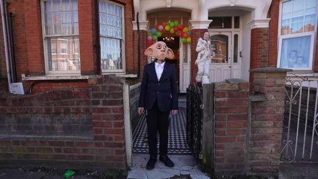 children celebrating purim stand in front of their house waiting for guests during purim on february 26, 2021 in london, england. last year's purim... - religion stock videos & royalty-free footage