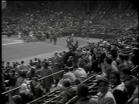 montage children cheering and waving in stadium seats the dodgers warming up on field pee wee reese and roy campanella signing autographs for eager... - ジャージーシティ点の映像素材/bロール