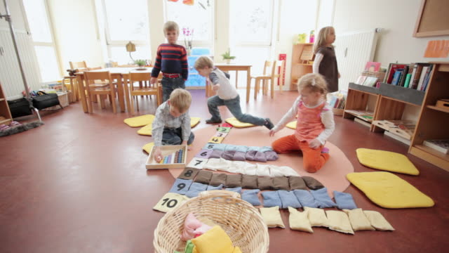 ms children clearing up bags and beads / potsdam, brandenburg, germany - preschool stock videos and b-roll footage